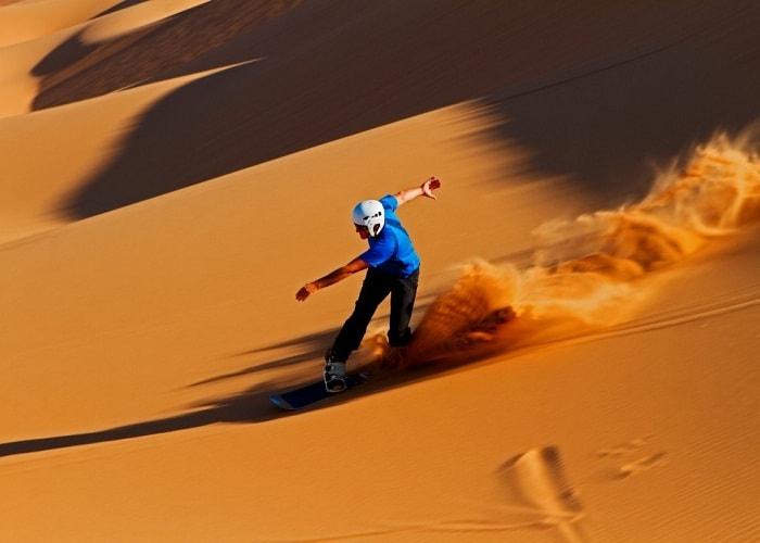 vip desert safari, land cruiser pick up, desert safari dubai vip desert safari image with peoples enjoying desert safari in dubai bes tour